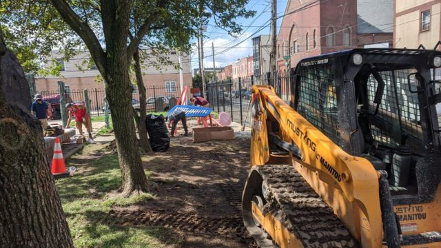 Construction crews install the musical playground at the East Passyunk Community Center
